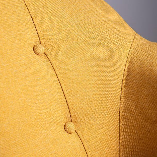 canapé jaune poussin avec boutons